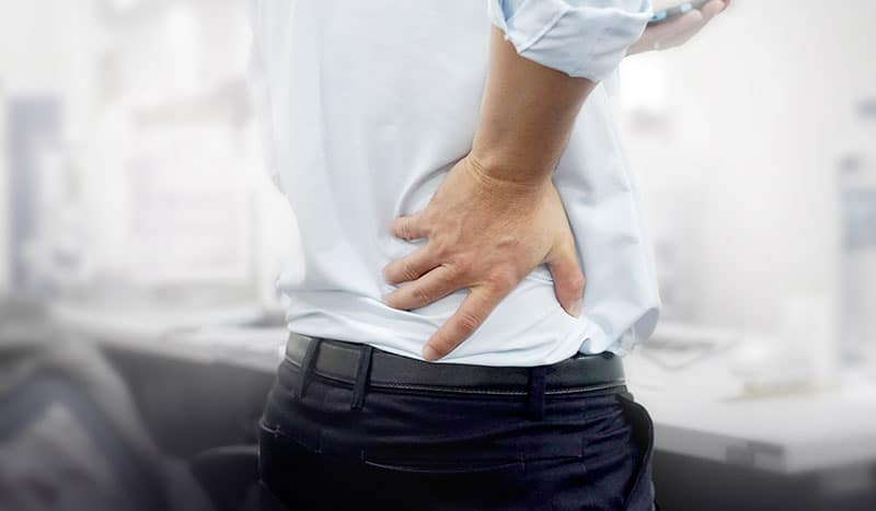 man with hand on lower back