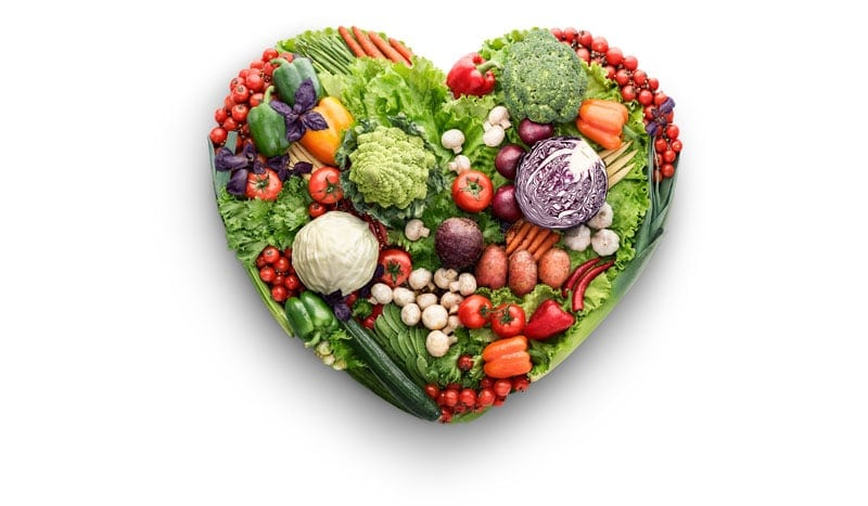 heart shaped plate of fresh vegetables
