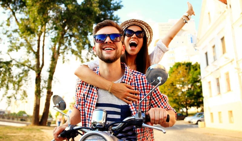 couple riding on motorbike, enjoying vacation after receiving a hangover iv or travel iv