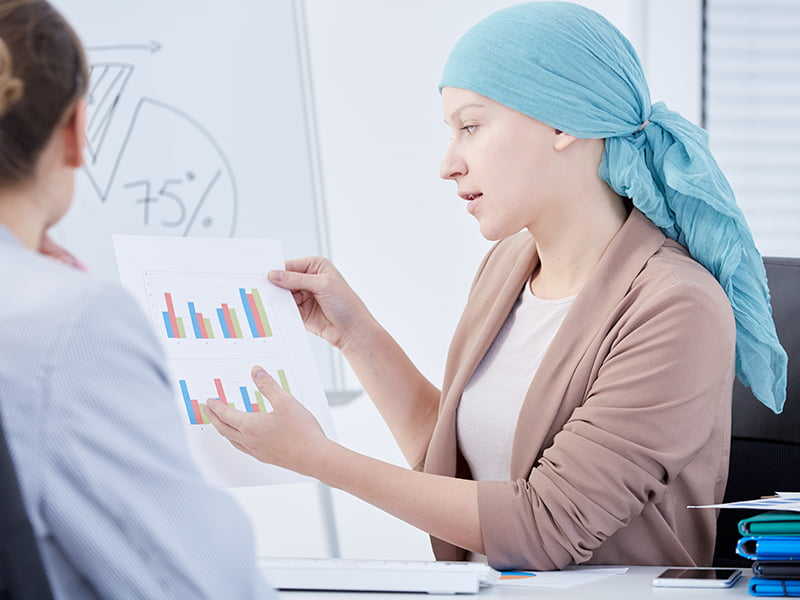 cancer patient and doctor discussing charts
