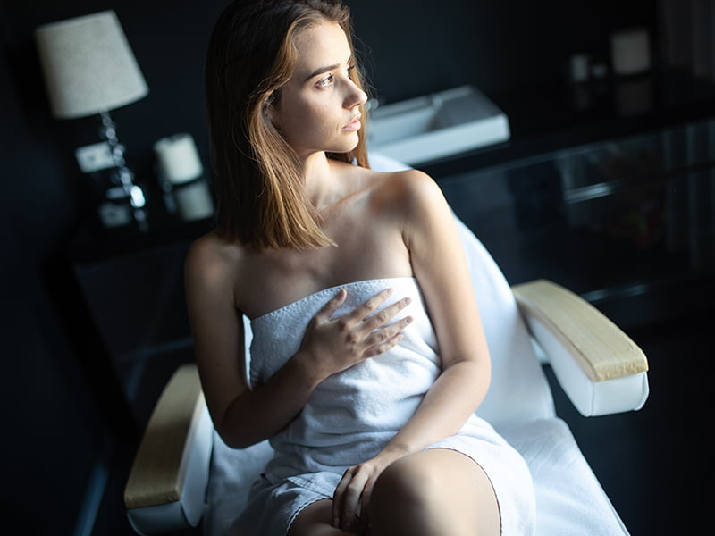 woman wrapped in towel in spa chair